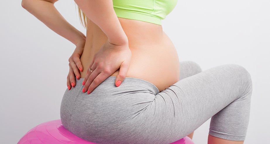 Почему болит копчик при беременности: возможные причины. Что делать?